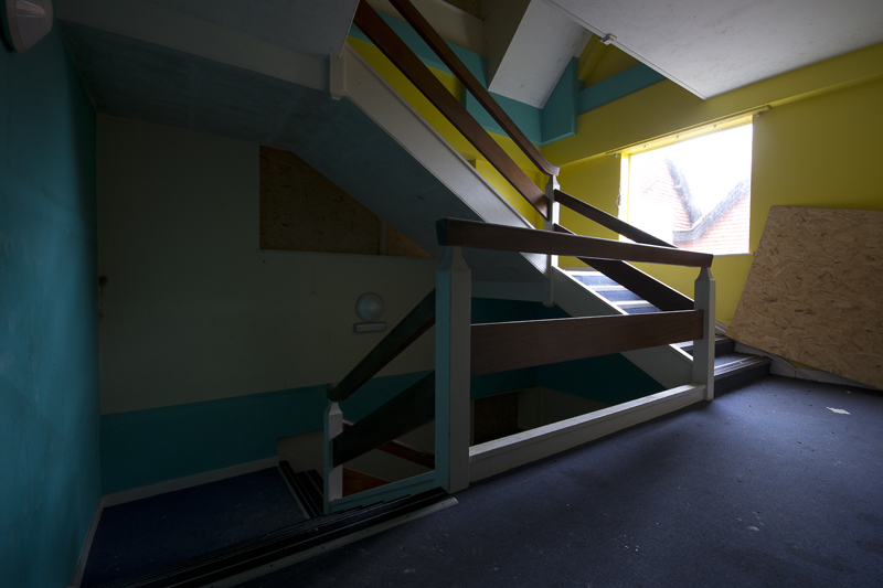 Brightly painted stairwell.
