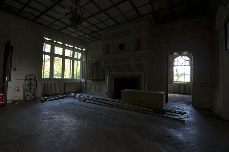 Inside the old building, a very grand fireplace.