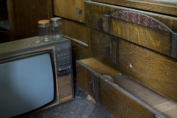 A TV and carved wood drawer.