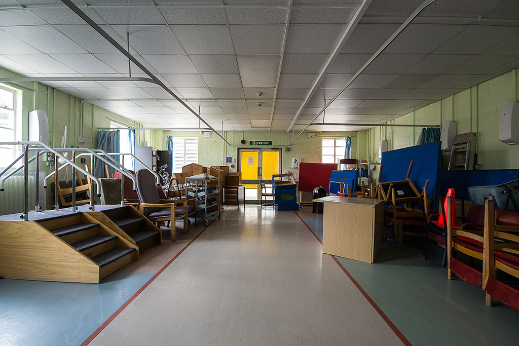 A ward, all of the furniture has been piled up ready for removal