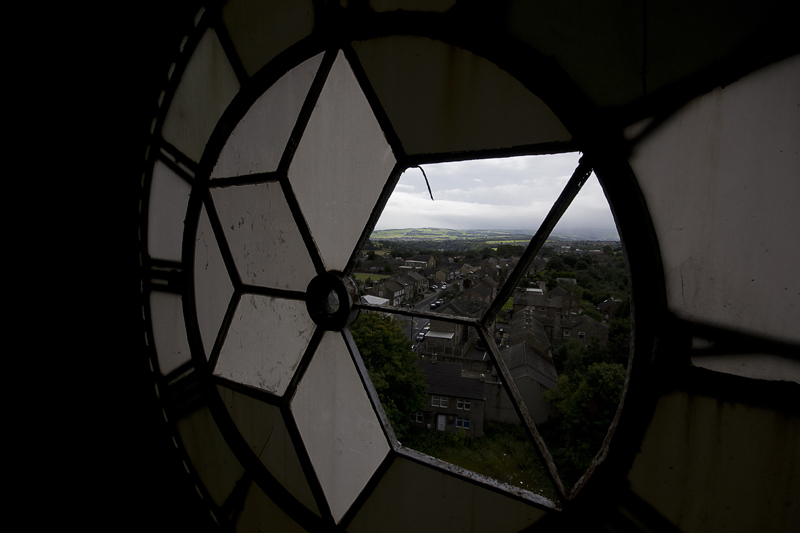 Looking down on the house through the clock face.