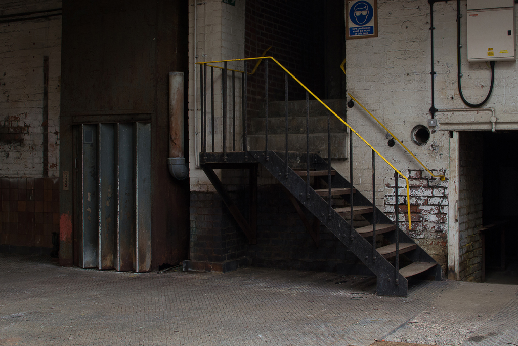 Lift and staircase in the warehouse part of the building.