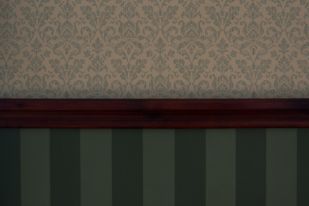 Wallpaper and dado rail.