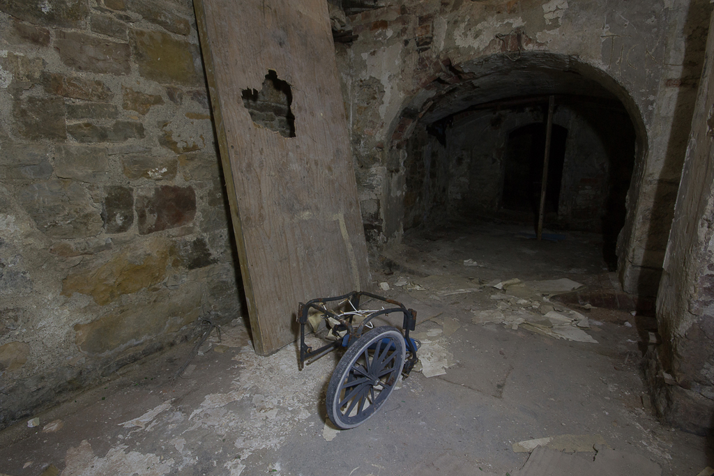 Part of a wheelchair in the basement.