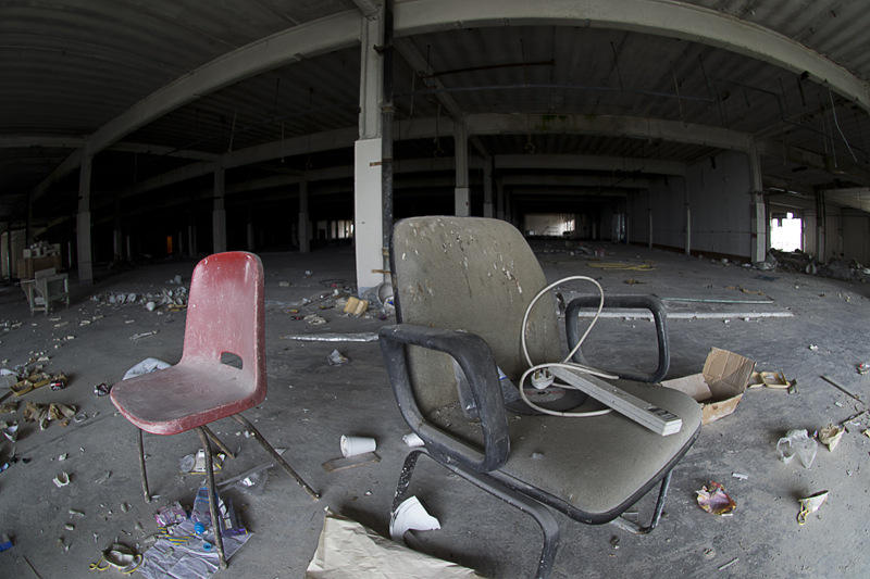 Some chairs, this large space was once jam packed with automated machinery.