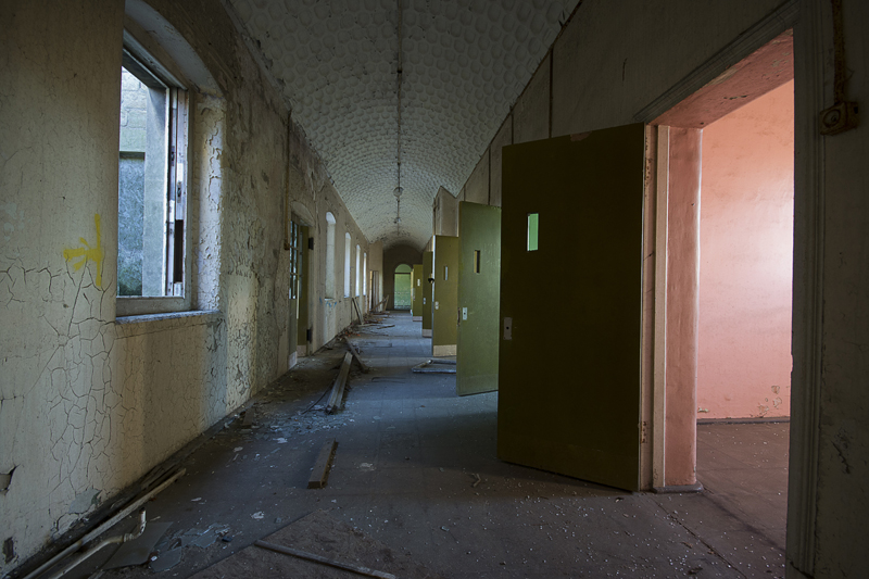 A corridor with doors off to the various individual patient rooms.