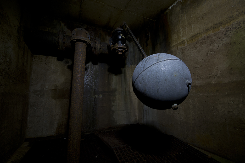Inside the ball valve chamber, which would prevent the reservoir from overfilling.