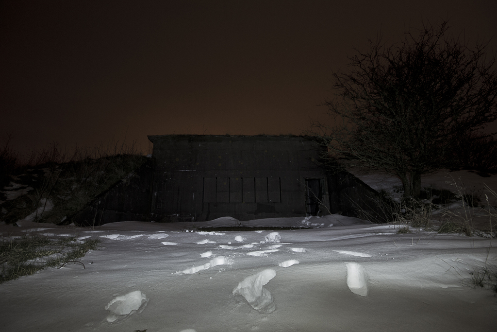 Our snowy track to the reservoir, the imposing concrete structure is the valve room.