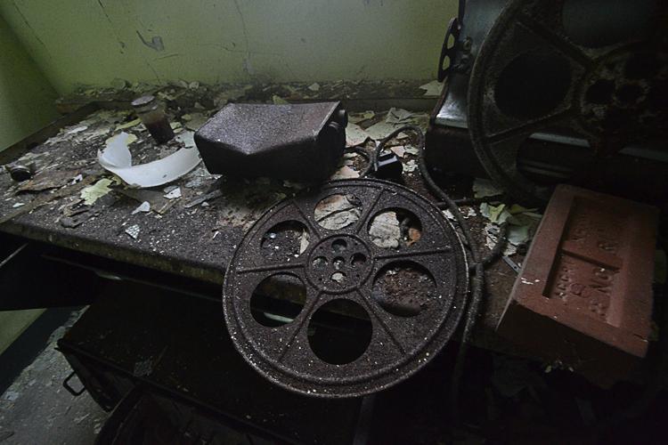 Empty film reels rusting away.
