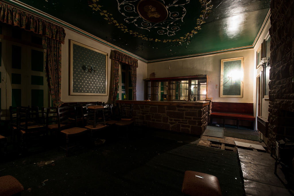 This room was recently used as a bar, the lovely listed ceiling clashes a bit with the modern additions.